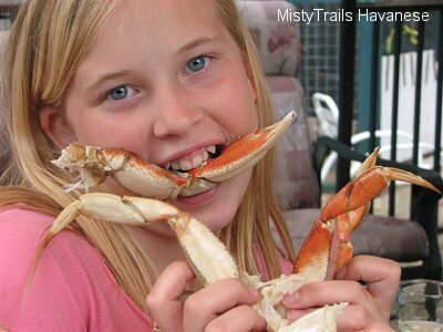 Girl Eating Crab Image