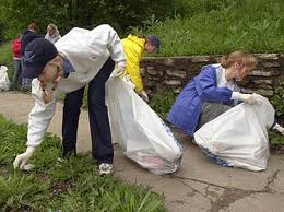 People Picking Up Trash Caring For Our World Image