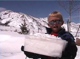 All About Snow Makes Water for Kids - Image of a Kid with a Bucket of Snow - Snow Makes Water Quiz