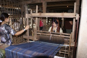 All about the Clever Girl an Italian Folk Story for Kids - a Picture of a Woman Using a Weaving Loom