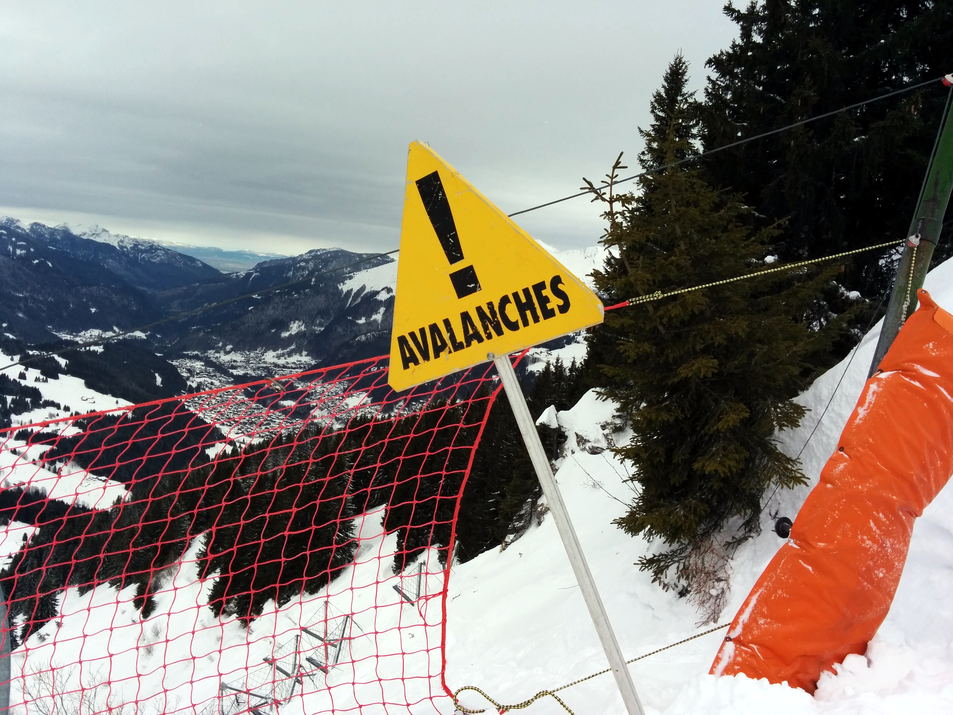 Avalanche Quiz - Avalanche Warning Sign on a Snowy Mountain image