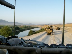 All about Politics Fun Geography Facts for Kids - Image of Military Vehicles on a Dusty Road