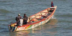 Fun Geography for Kids on Gambia - Image of a Brightly Painted Fishing Boat Common in Bakau, Gambia