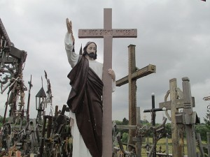 Fun Geography for Kids All About the Hill of Crosses - Image of a Cross with the Statue of Jesus in the Hill of Crosses