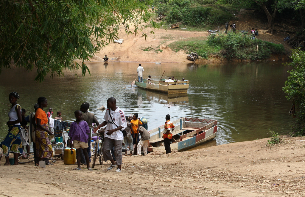 Geography for Kids Liberia Quiz - Image of People in Liberia Crossing a River by Boat
